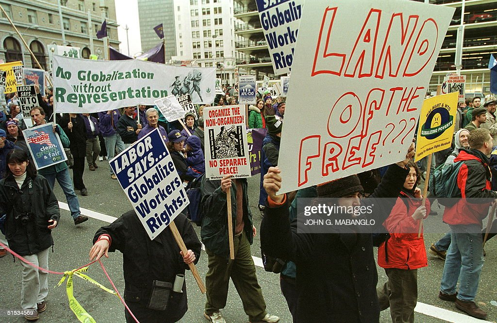 AntiWTO protesters from labor groups to environmental groups participate during a peaceful protest march 03 December 1999 in Seattle Washington...