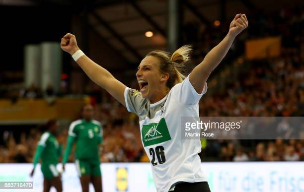 Antje Lauenroth of Germany celebrates after scoring a goal during the IHF Women's Handball World Championship group D match between Germany and...