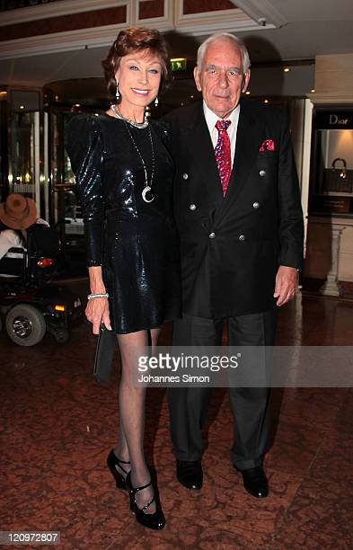 AntjeKatrin Kuehnemann and her husband Joerg Guehring attend the Susanne Wiebe Fashion Show on August 12 2011 in Munich Germany