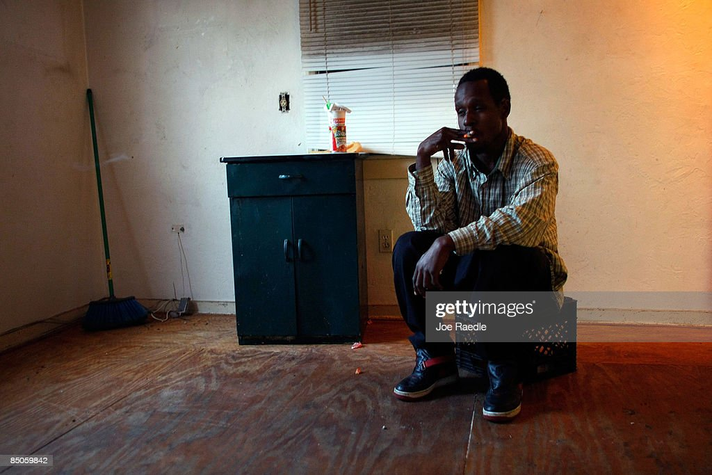 Antlee Accius sits in the former living room of the foreclosed home that he and his family reoccupied with the rest of his family after busting the locks and moving in with the help of the activist group 'Take Back the Land' February 24, 2009 in Miami, Florida. The family was evicted from the home and had been living in a van in the parking lot of a local supermarket since Friday when they were evicted. Mary Trody, her husband and her two children were living in the house and could not pay their bills due to what she says was predatory lending by a mortgage company. Her husband lost his job, which forced the couple and their two teenage children along with other relatives to move back in to the house before they lost it to foreclosure and now the bank owns the house.