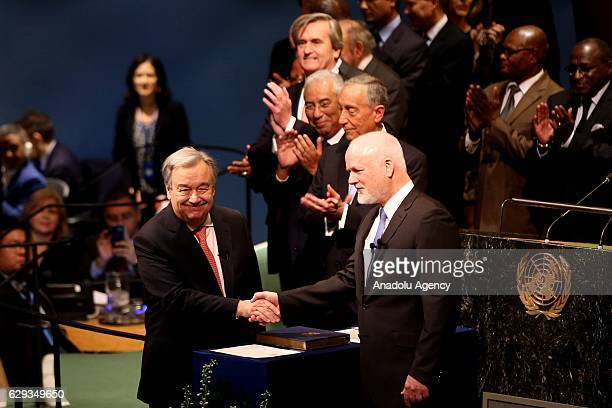 António Manuel de Oliveira Guterres shakes hands with Peter Thompson president of General Assembly after he took his oath swearing as 9th Secretary...