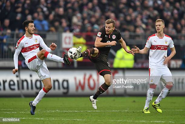 Anto Grgic of Stuttgart is challenged by Lennart Thy of St Pauli during the Second Bundesliga match between FC St Pauli and VfB Stuttgart at...