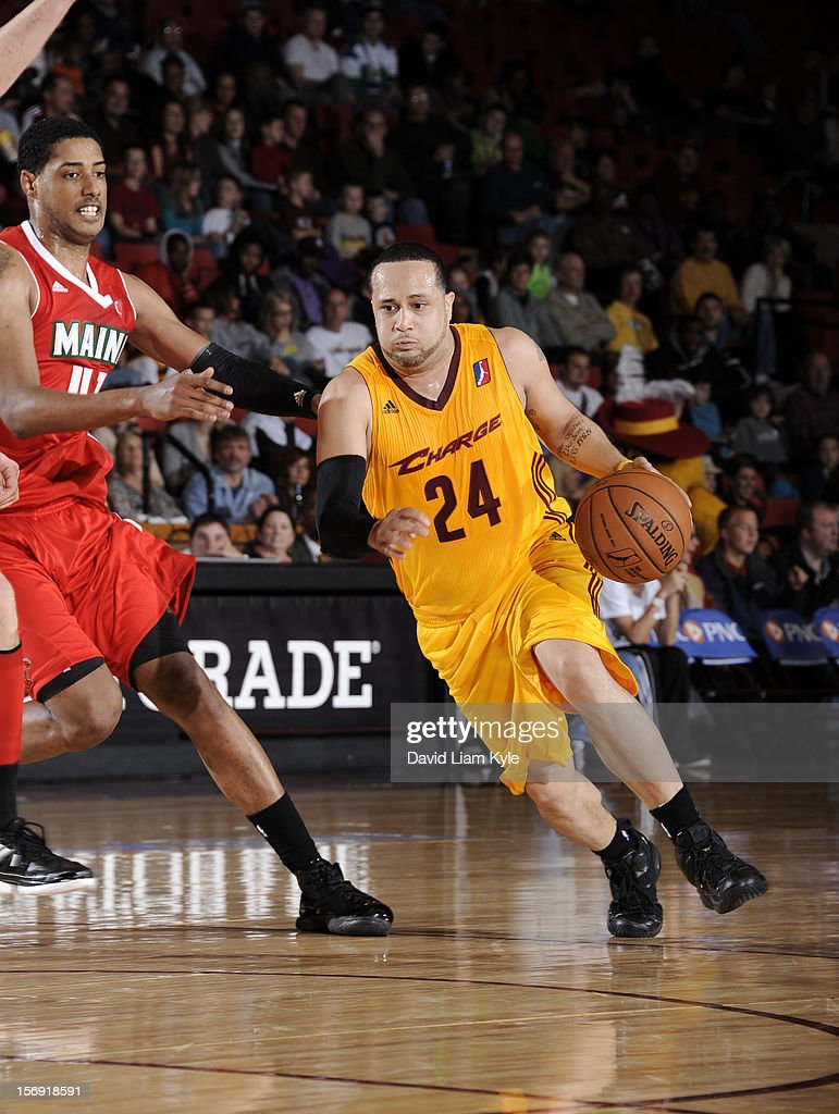 Antoine Agudio #24 of the Canton Charge drives to the hoop against Fab Melo #41 of the Maine Red Claws at the Canton Memorial Civic Center on November 23, 2012 in Canton, Ohio.