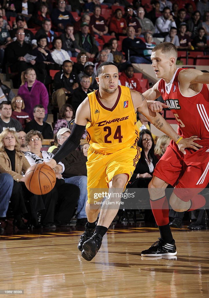 Antoine Agudio #24 of the Canton Charge drives to the hoop against Micah Downs #15 of the Maine Red Claws at the Canton Memorial Civic Center on November 23, 2012 in Canton, Ohio.