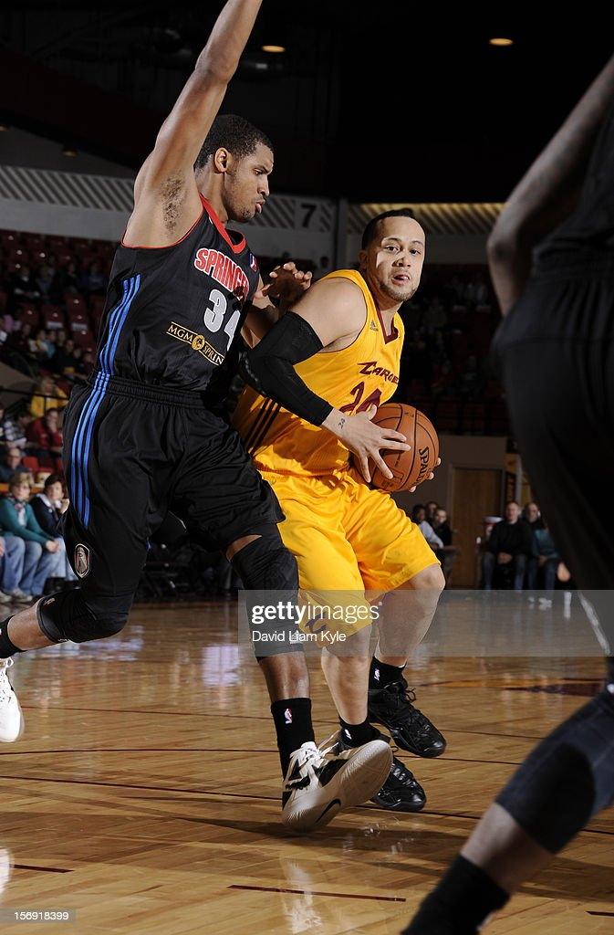 Antoine Agudio #24 of the Canton Charge drives to the hoop against <a gi-track='captionPersonalityLinkClicked' href=/galleries/search?phrase=Carleton+Scott&family=editorial&specificpeople=5638536 ng-click='$event.stopPropagation()'>Carleton Scott</a> #34 of the Springfield Armor at the Canton Memorial Civic Center on November 24, 2012 in Canton, Ohio.