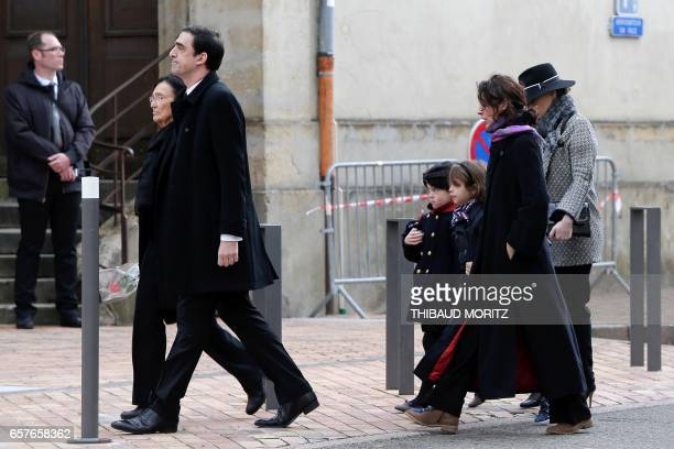 Antoine and Antonia Emmanuelli respectively the son and the widow of French Socialist Party's politician Henri Emmanuelli walk outside the Madeleine...
