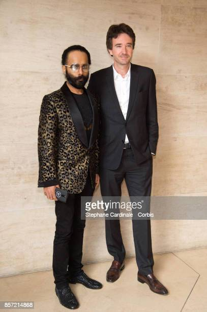 Antoine Arnault and guest attend the Louis Vuitton show as part of the Paris Fashion Week Womenswear Spring/Summer 2018 at Musee du Louvre on October...