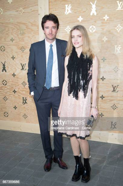 Antoine Arnault and Natalia Vodianova attend the Louis Vuitton's Dinner for the Launch of Bags by Artist Jeff Koons at Musee du Louvre on April 11...