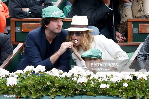Antoine Arnault his companion Natalia Vodianova and her son sighting at the Roland Garros Tennis French Open 2013 Day 15 on June 9 2013 in Paris...