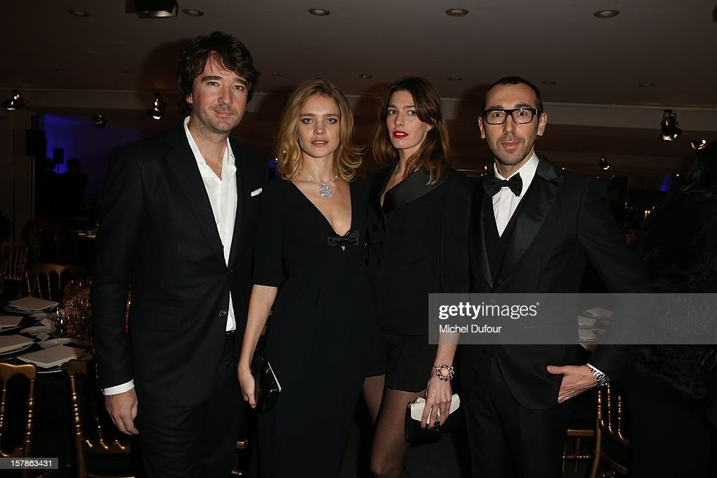 Antoine Arnault, Natalia Vodianova, guest and Alessandro sartori attend the Babeth Djian Hosts Dinner For Rwanda To The Benefit Of A.E.M. on December 6, 2012 in Paris, France.