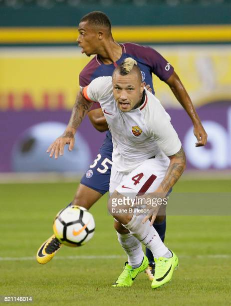Antoine Bernede of Paris SaintGermain and Radja Nainggolan of AS Roma chases a ball during the second half at Comerica Park on July 19 2017 in...