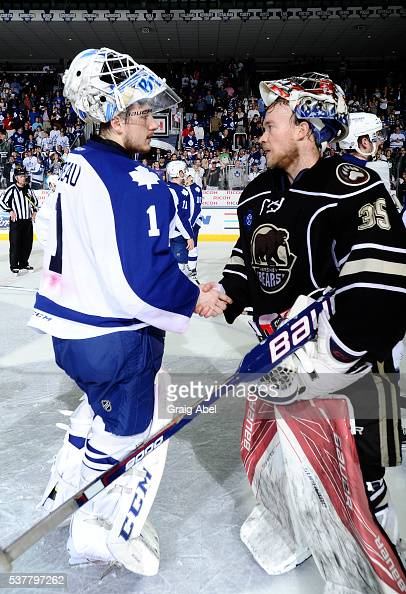Antoine Bibeau of the Toronto Marlies shake hands with Justin Peters of the Hershey Bears after the Bears series victory during AHL Eastern...