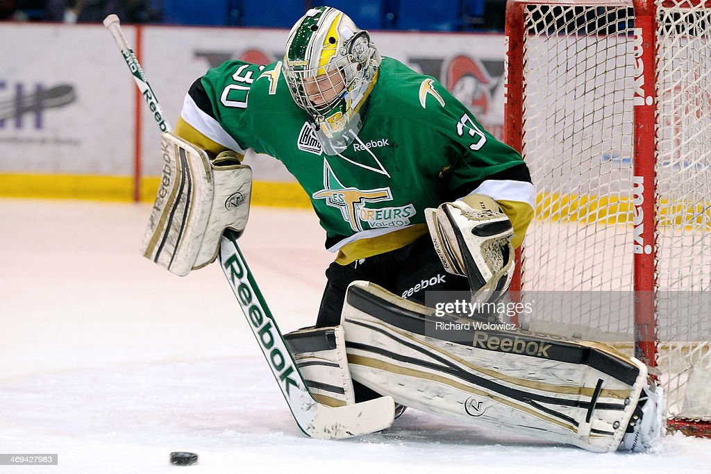Antoine Bibeau #30 of the Val D'Or Foreurs gets down to stop the puck during the QMJHL game against the Drummondville Voltigeurs at the Centre Marcel Dionne on February 14, 2014 in Drummondville, Quebec, Canada.