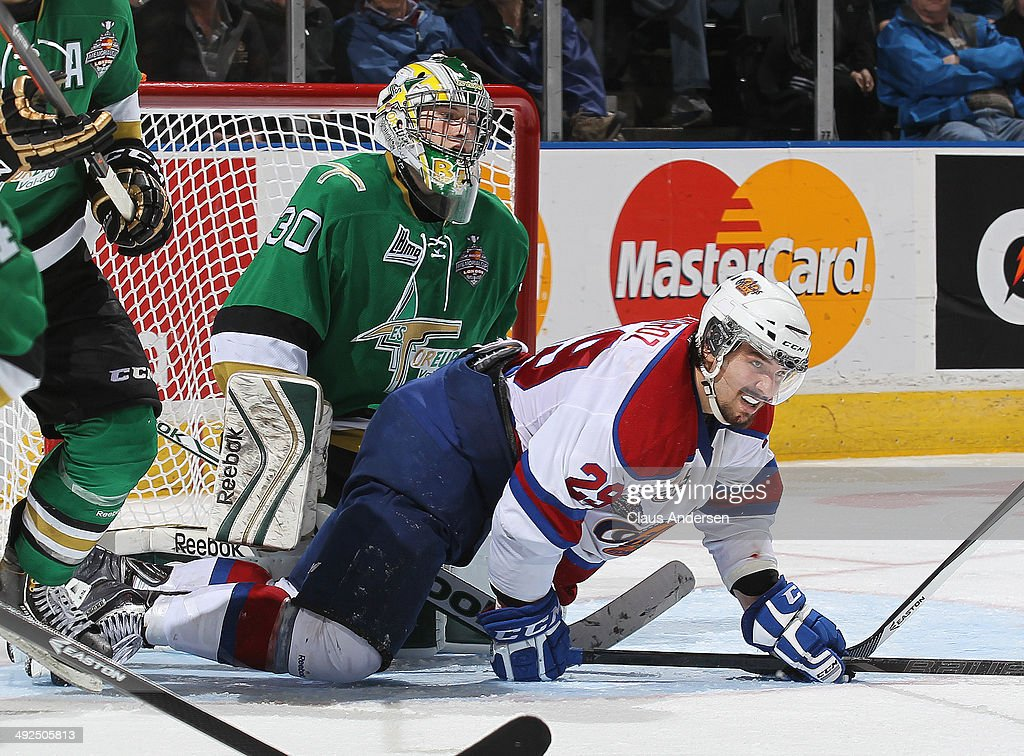 Antoine Bibeau #30 of the Val'Dor Foreurs has Mitchell Moroz #29 of the Edmonton Oil Kings slide into him during Game Five of the 2014 MasterCard Memorial Cup at Budweiser Gardens on May 20, 2014 in London, Ontario, Canada. The Foreurs defeated the Oil Kings 4-3 in double overtime.