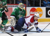 Antoine Bibeau of the Val'Dor Foreurs has Mitchell Moroz of the Edmonton Oil Kings slide into him during Game Five of the 2014 MasterCard Memorial...