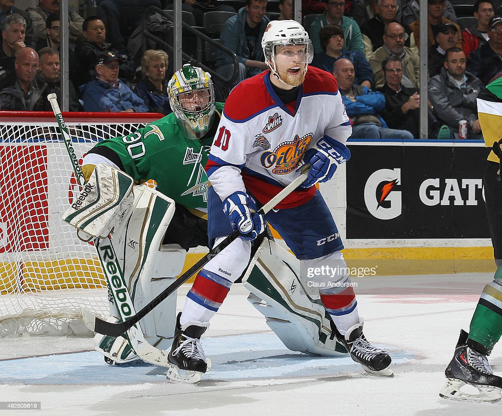 Antoine Bibeau #30 of the Val'Dor Foreurs looks around Henrik Samuelsson #10 of the Edmonton Oil Kings during Game Five of the 2014 MasterCard Memorial Cup at Budweiser Gardens on May 20, 2014 in London, Ontario, Canada. The Foreurs defeated the Oil Kings 4-3 in double overtime.