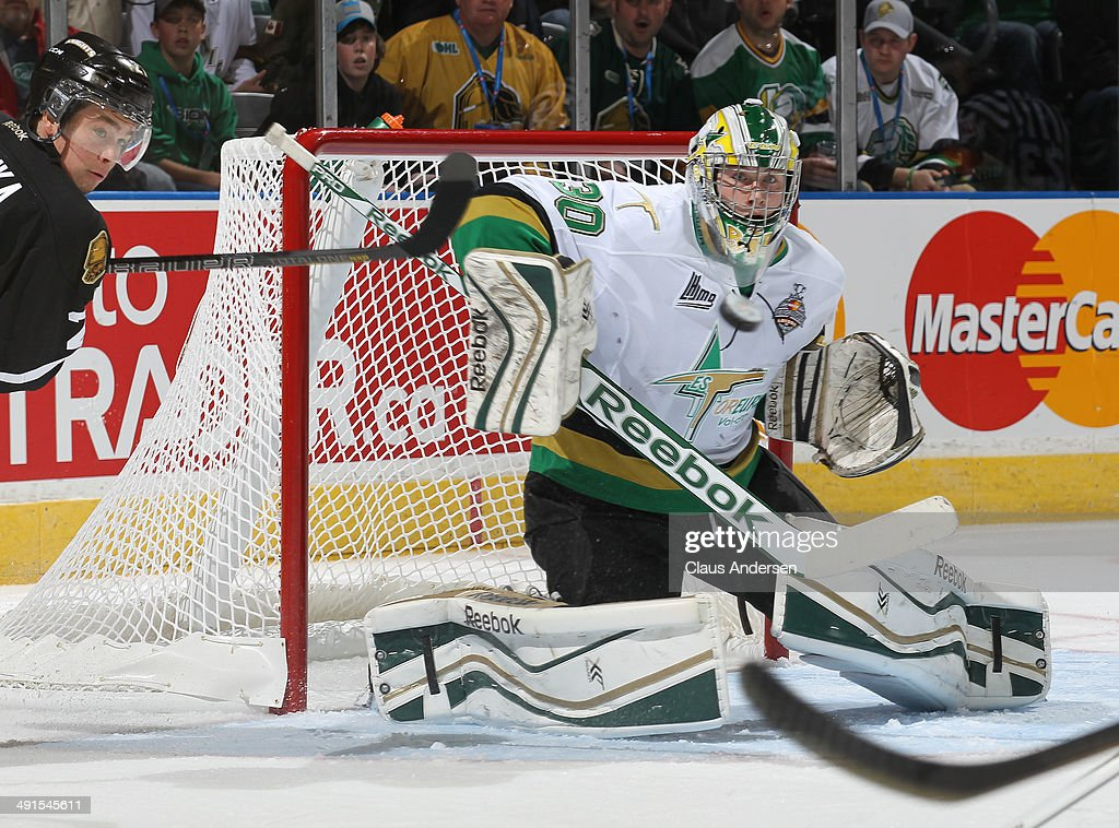 Antoine Bibeau #30 of the Val'Dor Foreurs looks at an incoming shot against the London Knights in Game One of the 2014 Mastercard Memorial Cup Championship at the Budweiser Gardens on May 16, 2014 in London, Ontario, Canada.