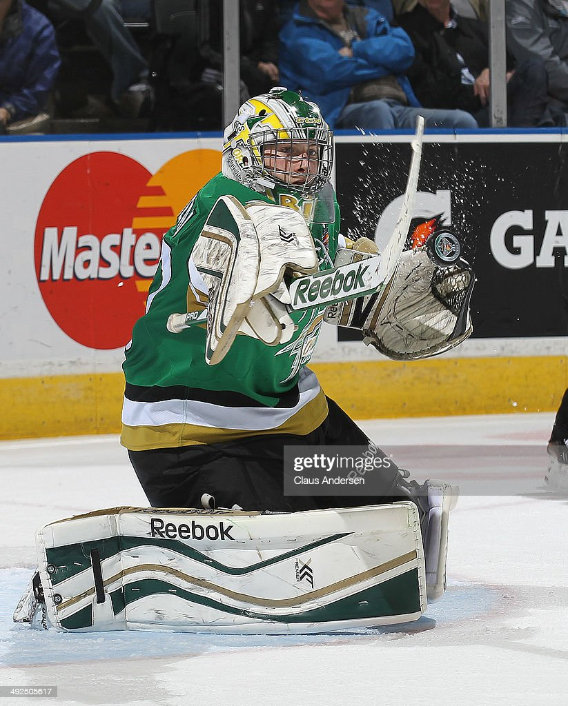 Antoine Bibeau #30 of the Val'Dor Foreurs makes a big stop against the Edmonton Oil Kings during Game Five of the 2014 MasterCard Memorial Cup at Budweiser Gardens on May 20, 2014 in London, Ontario, Canada. The Foreurs defeated the Oil Kings 4-3 in double overtime.
