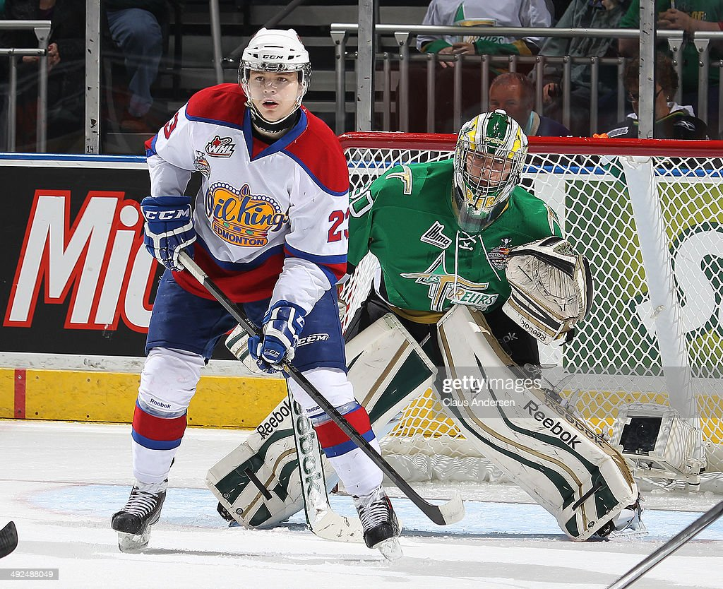 Antoine Bibeau #30 of the Val'Dor Foreurs tries to look past Edgars Kulda #23 of the Edmonton Oil Kings in Game Five of the 2014 MasterCard Memorial Cup at Budweiser Gardens on May 20, 2014 in London, Ontario, Canada.