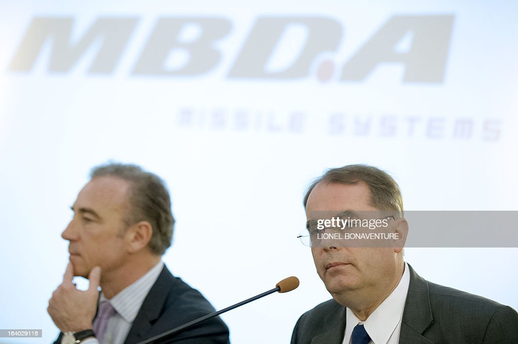 Antoine Bouvier (R), the CEO of the MBDA Missile Systems company and Franck le Rebeller (L), Group Finance controller and accounting Director, attend a press conference to present the group's 2012 results in Paris on March 19, 2013.