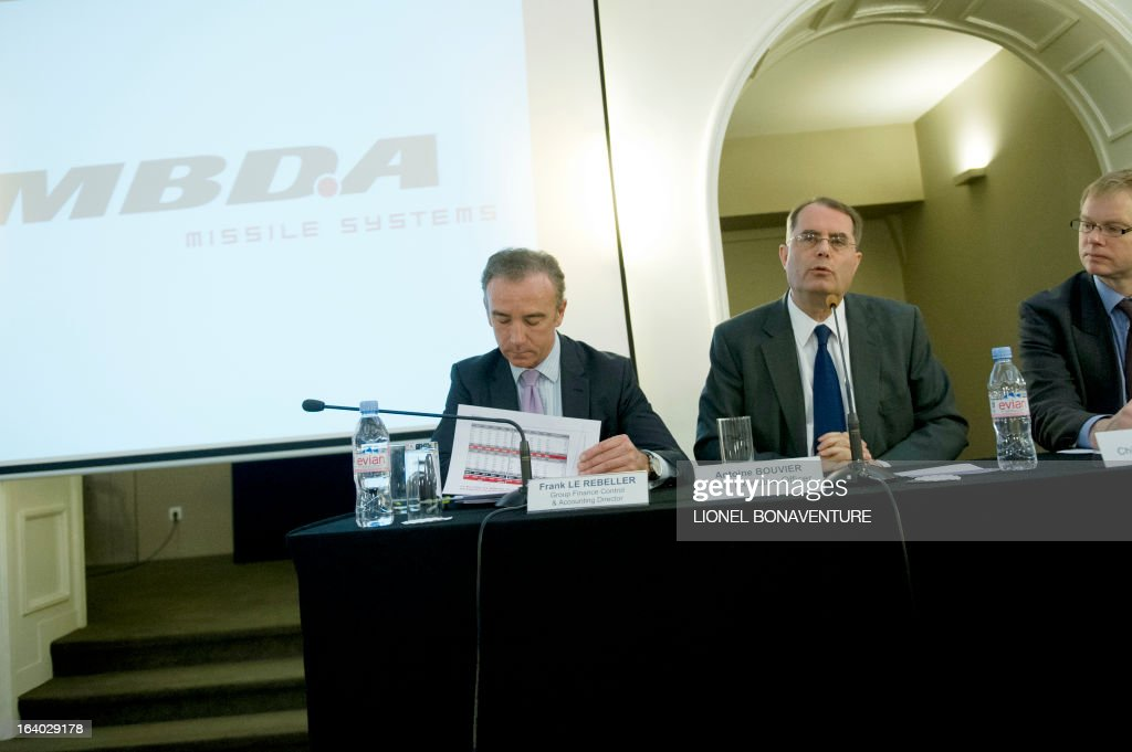 Antoine Bouvier (2ndR), the CEO of the MBDA Missile Systems company speaks with Franck le Rebeller (L), Group Finance controller and accounting Director, and Chief Finance Officer Peter Bols (R), during a press conference to present the group's 2012 results in Paris on March 19, 2013.
