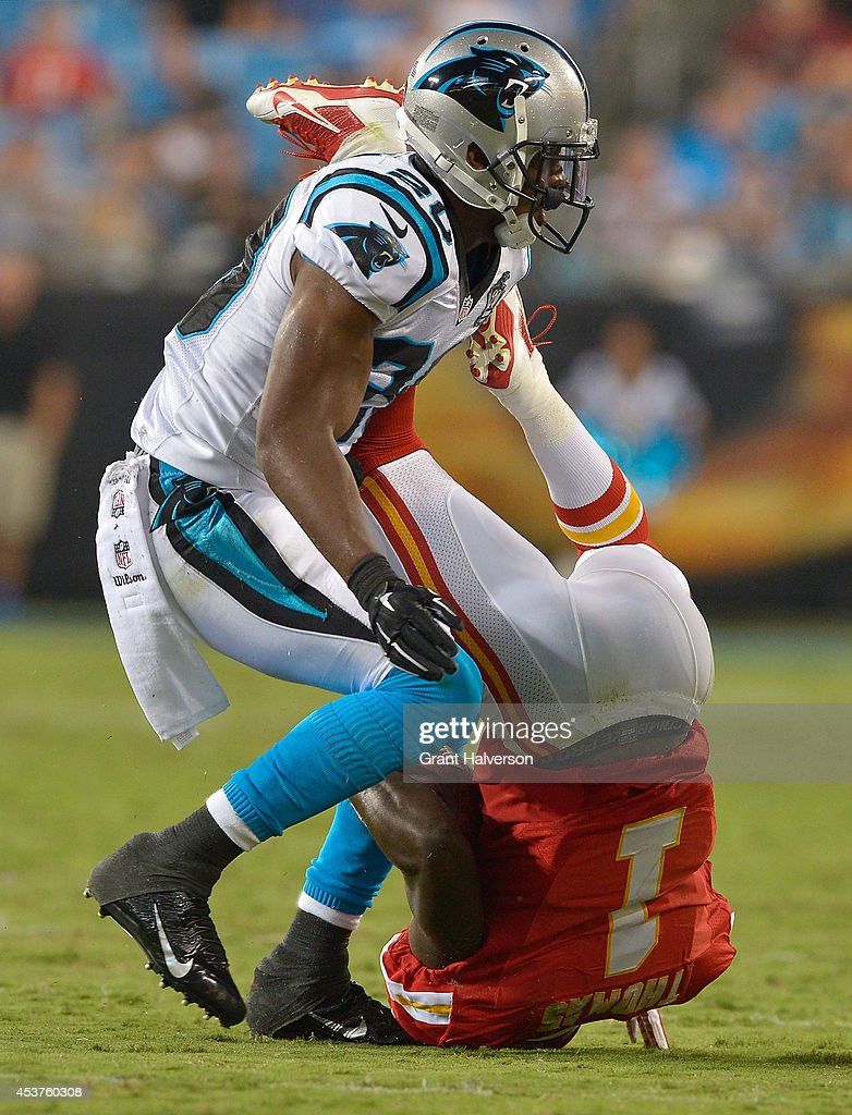 <a gi-track='captionPersonalityLinkClicked' href=/galleries/search?phrase=Antoine+Cason&family=editorial&specificpeople=2803078 ng-click='$event.stopPropagation()'>Antoine Cason</a> #20 of the Carolina Panthers upends <a gi-track='captionPersonalityLinkClicked' href=/galleries/search?phrase=De%27Anthony+Thomas&family=editorial&specificpeople=8222432 ng-click='$event.stopPropagation()'>De'Anthony Thomas</a> #1 of the Kansas City Chiefs during their game at Bank of America Stadium on August 17, 2014 in Charlotte, North Carolina.