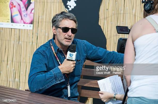 Antoine de Caunes is being interviewed at Festivak Solidays at Hippodrome de Longchamp on June 22 2012 in Paris France