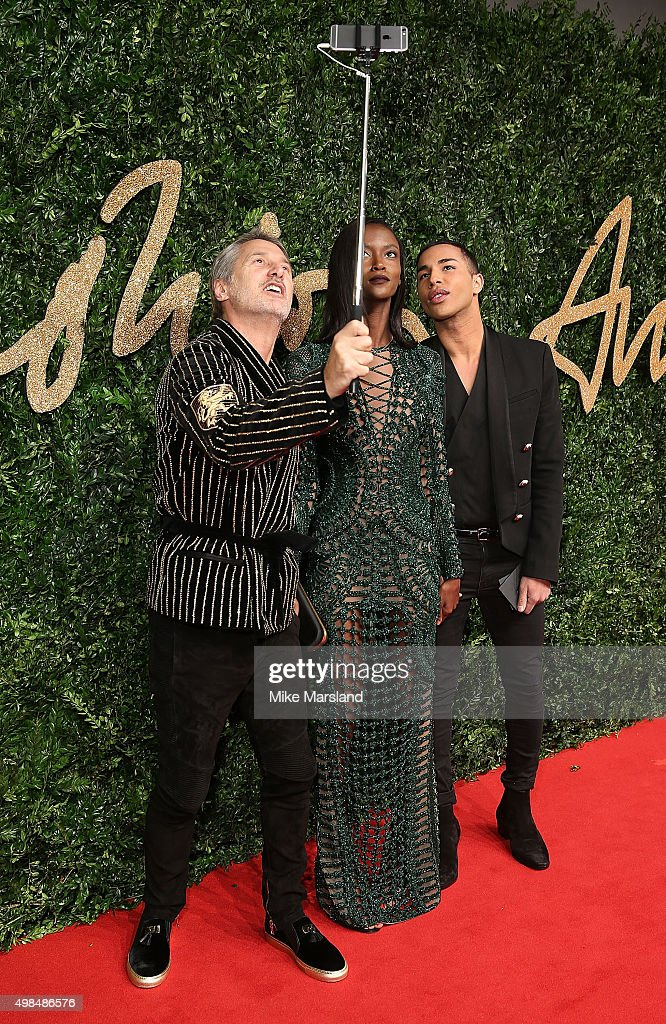Antoine de Caunes, Riley Montana and Olivier Rousteing attend the British Fashion Awards 2015 at London Coliseum on November 23, 2015 in London, England.