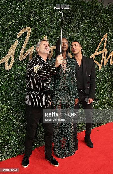 Antoine de Caunes Riley Montana and Olivier Rousteing attend the British Fashion Awards 2015 at London Coliseum on November 23 2015 in London England