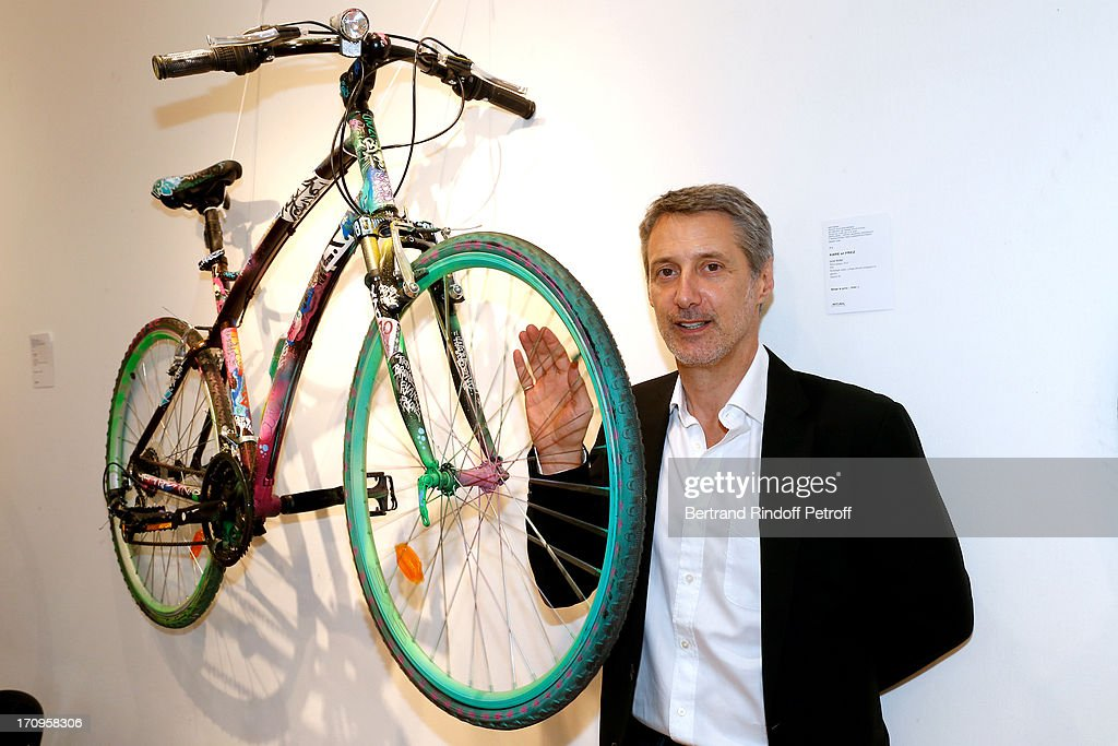 Antoine de Caunes who plays the auctioneer standing near the bike from Xare and Frez at 'Arty Bike' Auction to benefit Association des Tout P'tits at Artcurial on June 20, 2013 in Paris, France.