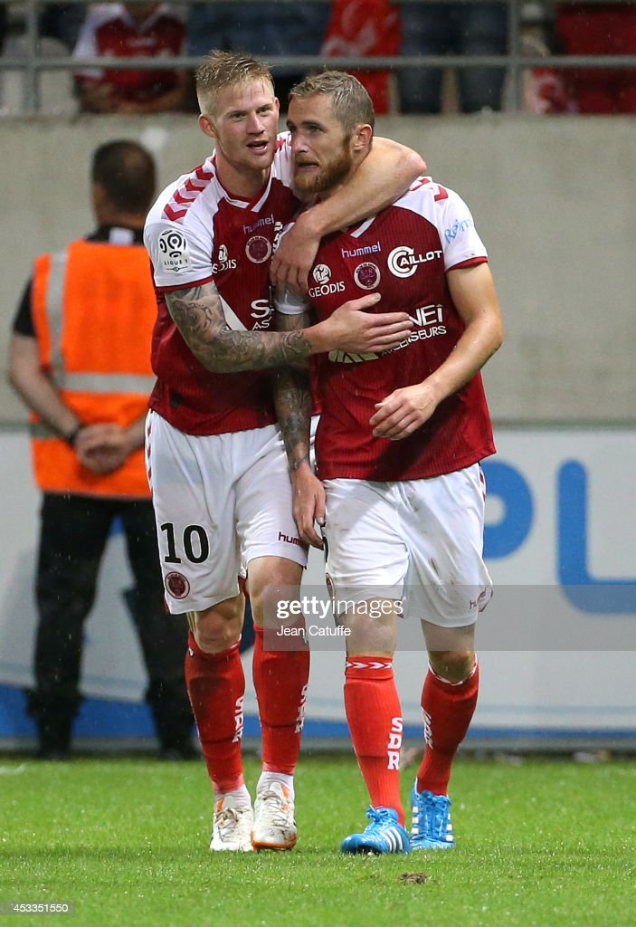 <a gi-track='captionPersonalityLinkClicked' href=/galleries/search?phrase=Antoine+Devaux&family=editorial&specificpeople=5868148 ng-click='$event.stopPropagation()'>Antoine Devaux</a> of Stade de Reims (right) celebrates his goal with Gaetan Charbonnier of Stade de Reims during the French Ligue 1 match between Stade de Reims and Paris Saint Germain FC at the Stade Auguste Delaune on August 8, 2014 in Reims, France.