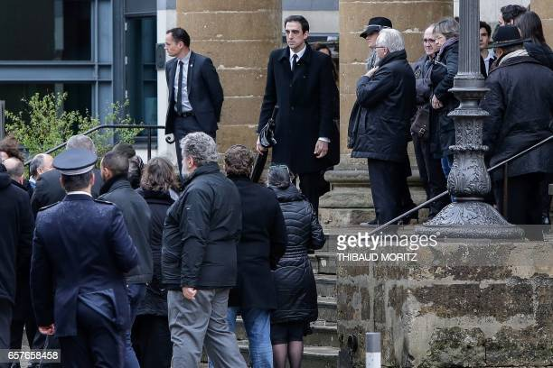 Antoine Emmanuelli the son of French Socialist Party's politician Henri Emmanuelli leaves the Madeleine church during his funeral on March 25 2017 in...