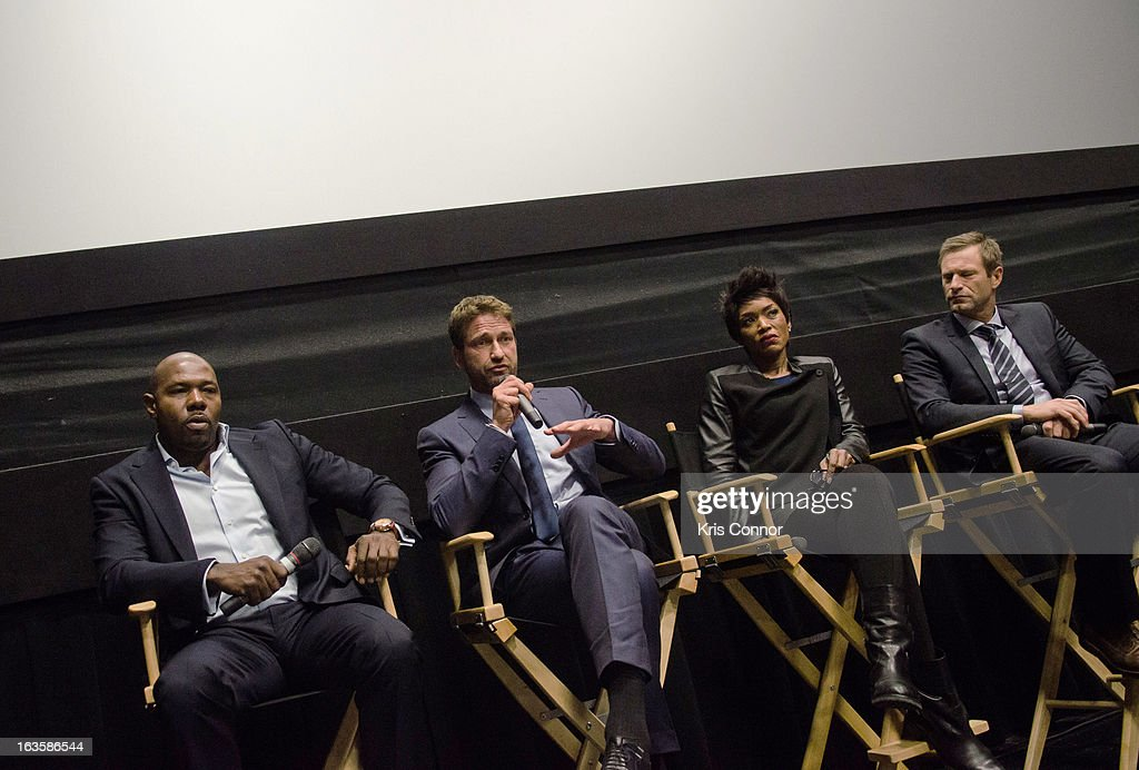 Antoine Fuqua, Gerard Butler, Angela Bassett and Aaron Eckhart speak during the 'Olympus Has Fallen' screening at AMC Loews Georgetown 14 on March 12, 2013 in Washington, DC.