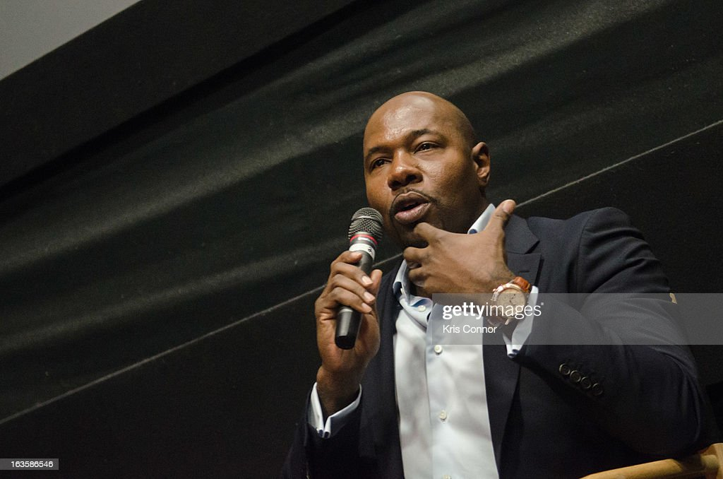 Antoine Fuqua speaks during the 'Olympus Has Fallen' screening at AMC Loews Georgetown 14 on March 12, 2013 in Washington, DC.