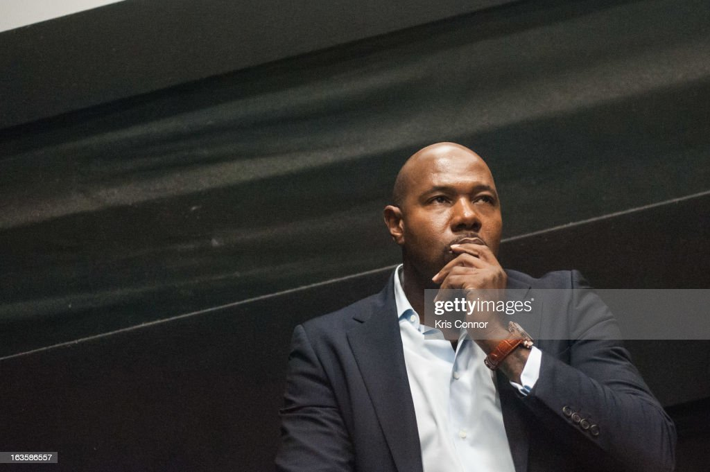 <a gi-track='captionPersonalityLinkClicked' href=/galleries/search?phrase=Antoine+Fuqua&family=editorial&specificpeople=2480782 ng-click='$event.stopPropagation()'>Antoine Fuqua</a> speaks during the 'Olympus Has Fallen' screening at AMC Loews Georgetown 14 on March 12, 2013 in Washington, DC.