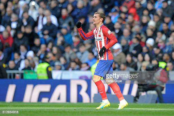 Antoine Greizmann of Club Atletico de Madrid celebrates after scoring his team's opening goal during the La Liga match between Real Madrid CF and...