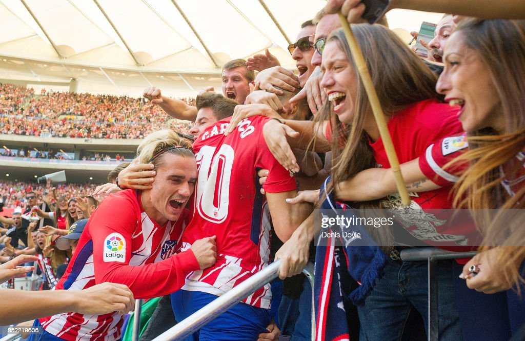 Antoine Greizmann of Club Atletico de Madrid celebrates with fans after his side scored their teamÕs 1st goal during the La Liga match between Atletico Madrid and Sevilla at Wanda Metropolitano on September 23, 2017 in Madrid, Spain.