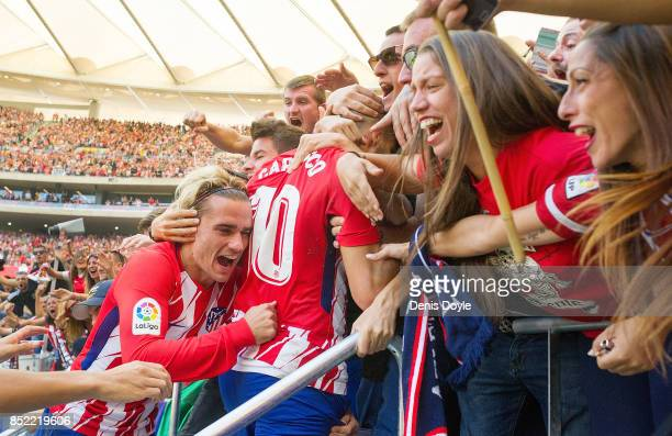 Antoine Greizmann of Club Atletico de Madrid celebrates with fans after his side scored their teamÕs 1st goal during the La Liga match between...