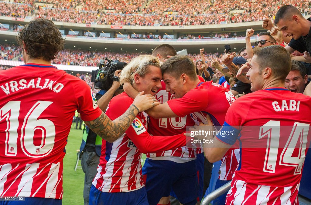 Antoine Greizmann of Club Atletico de Madrid celebrates with fans after his side scored their team's 1st goal during the La Liga match between Atletico Madrid and Sevilla at Wanda Metropolitano on September 23, 2017 in Madrid, Spain.