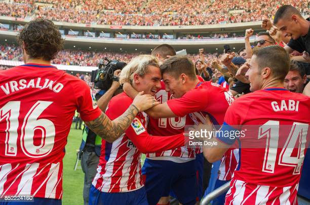 Antoine Greizmann of Club Atletico de Madrid celebrates with fans after his side scored their team's 1st goal during the La Liga match between...