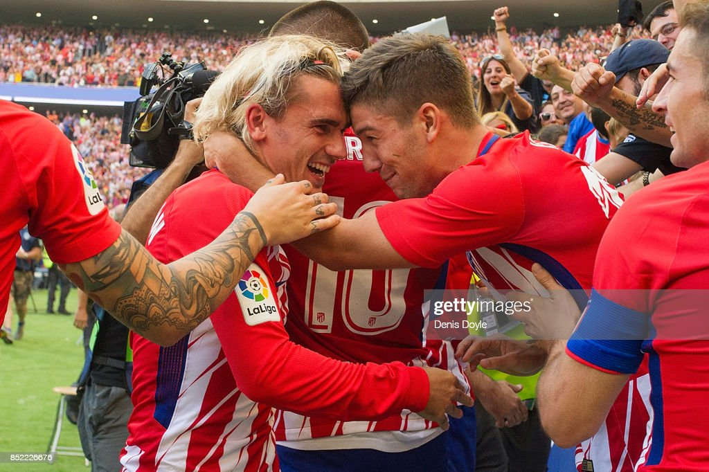 Antoine Greizmann of Club Atletico de Madrid celebrates with fans after his side scored their first goal during the La Liga match between Atletico Madrid and Sevilla at Wanda Metropolitano on September 23, 2017 in Madrid, Spain.