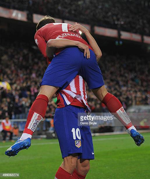 Antoine Greizmann of Club Atletico de Madrid celebrates with Oliver Torres after scoring his team's opening goal during the La Liga match between...