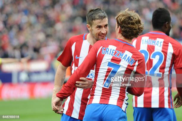 Antoine Griezmann #7 of Atletico de Madrid is congratulated by Gabi #14 of Atletico de Madrid after scoring goal during The La Liga match between...