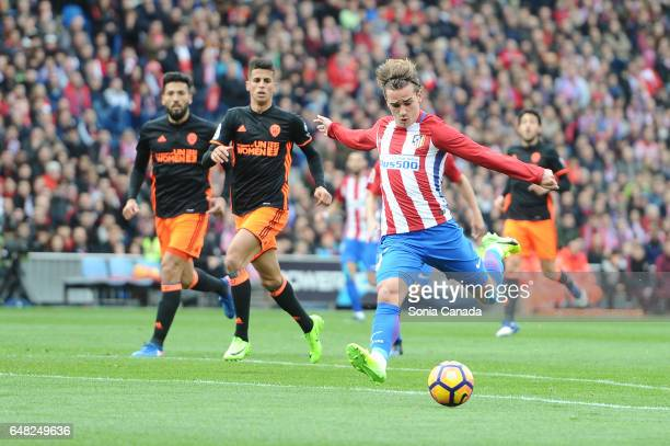 Antoine Griezmann #7 of Atletico de Madrid scores to make it 10 during The La Liga match between Atletico Madrid v Valencia CF at Vicente Calderon on...