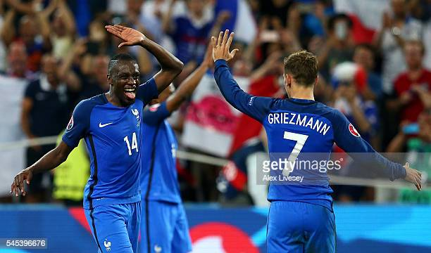 Antoine Griezmann and Blaise Matuidi of France celebrate their team's 20 win after the UEFA EURO semi final match between Germany and France at Stade...