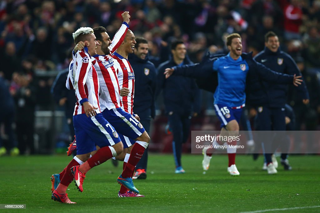 Antoine Griezmann and Jesus Gamez of Atletico Madrid celebrate victory after the penalty shoot out during the UEFA Champions League round of 16 match between Club Atletico de Madrid and Bayer 04 Leverkusen at Vicente Calderon Stadium on March 17, 2015 in Madrid, Spain.