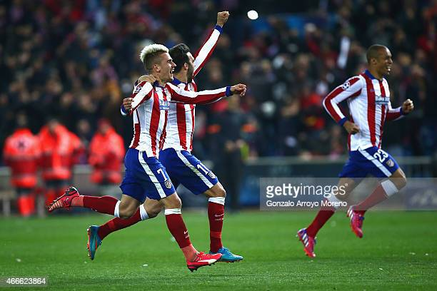 Antoine Griezmann and Jesus Gamez of Atletico Madrid celebrate after the penalty shoot out the UEFA Champions League round of 16 match between Club...
