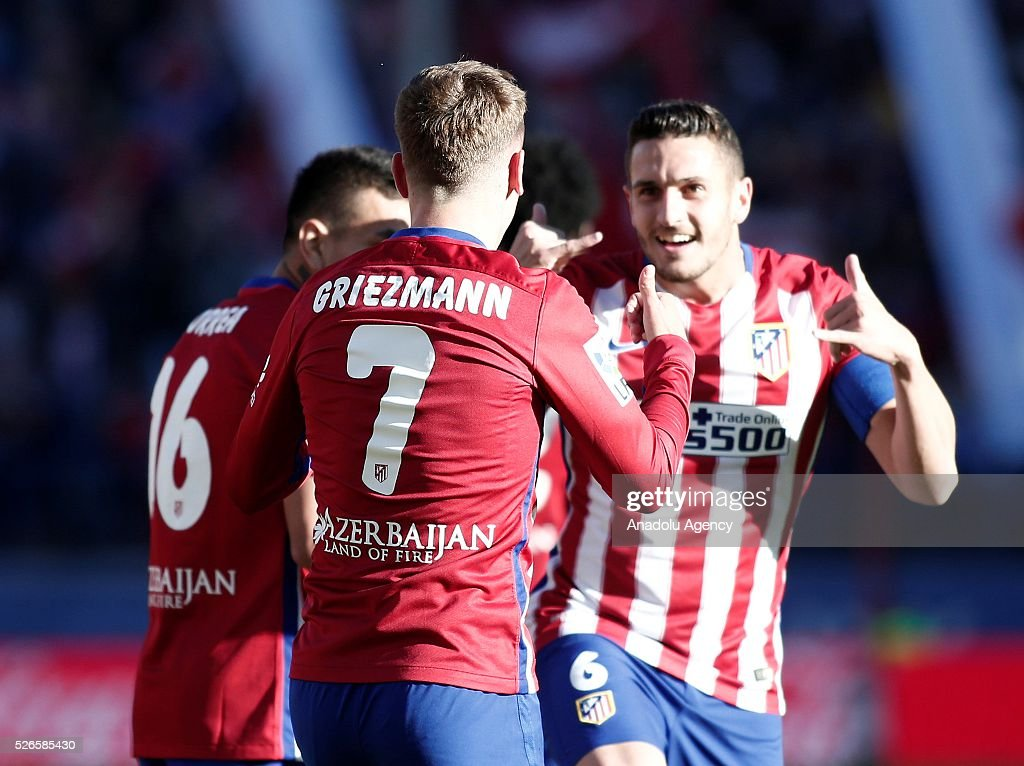 Antoine Griezmann (L) and Koke (R) of Atletico Madrid celebrate their team's goal during the La Liga football match between Atletico Madrid and Rayo Vallecano at Vicente Calderon, in Madrid, Spain on April 30, 2016.