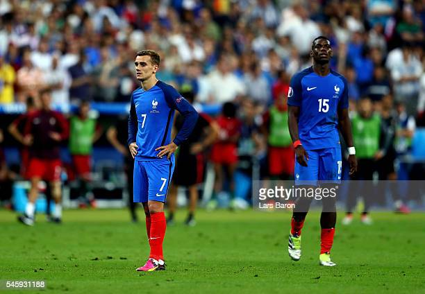 Antoine Griezmann and Paul Pogba of France show their dejection after the final whistle of the UEFA EURO 2016 Final match between Portugal and France...