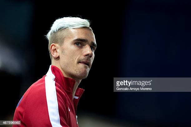 Antoine Griezmann bites his tongue as he enters the pitch prior to start the UEFA Champions League round of 16 second leg match between Club Atletico...
